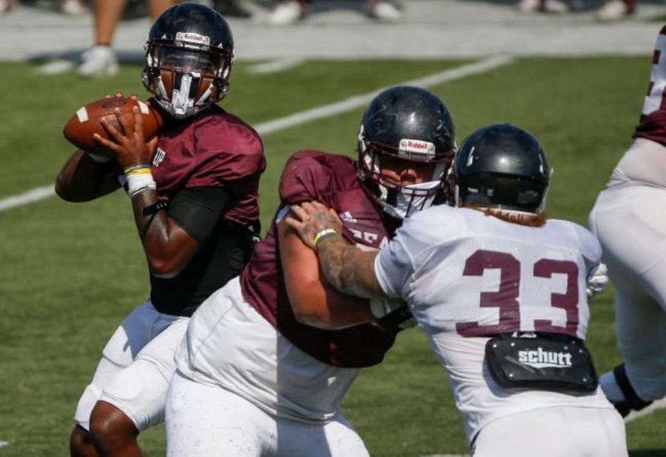 Photo -  Missouri State quarterback Jaden Johnson looks to pass the ball during a scrimmage at Plaster Stadium on Aug. 21 in Springfield. [Andrew Jansen/News-Leader]