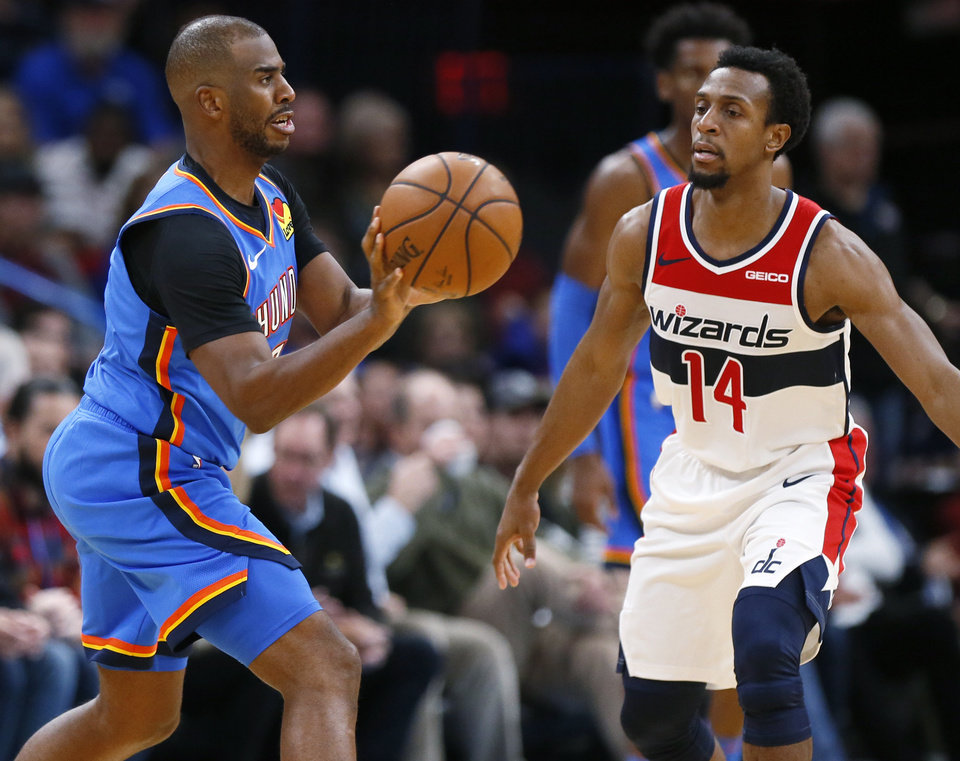 Photo - Oklahoma City's Chris Paul (3) passes the ball away from Washington's Ish Smith (14) in the fourth quarter during an NBA basketball game between the Oklahoma City Thunder and the Washington Wizards at Chesapeake Energy Arena in Oklahoma City, Friday, Oct. 25, 2019. The Wizards won 97-85. [Nate Billings/The Oklahoman]