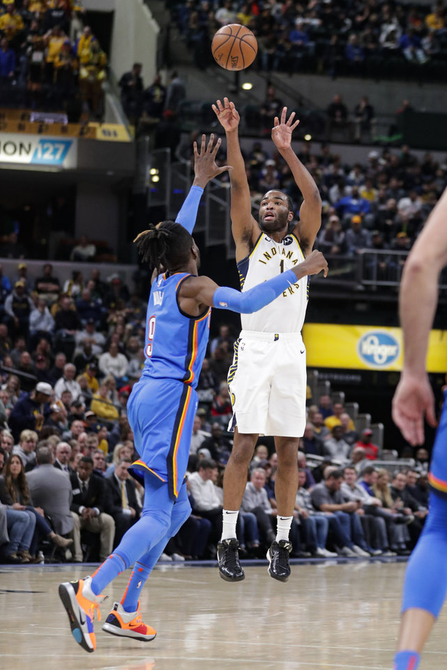Photo - Indiana Pacers forward T.J. Warren (1) shoots over Oklahoma City Thunder forward Nerlens Noel (9) during the second half of an NBA basketball game in Indianapolis, Tuesday, Nov. 12, 2019. The Pacers won 111-85. (AP Photo/Michael Conroy)