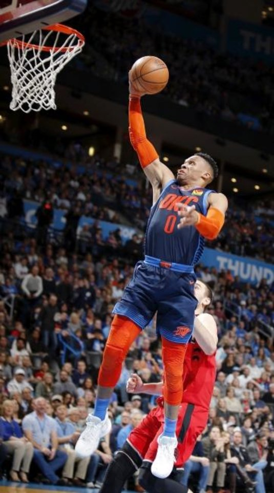 Photo -  Oklahoma City's Russell Westbrook goes to the basket during Wednesday night's game against Toronto at Chesapeake Energy Arena. [Sarah Phipps/The Oklahoman]