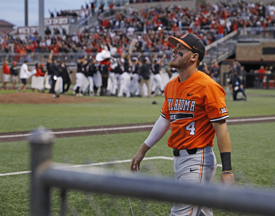 Photo - Oklahoma State's Andrew Navigato (4) walks off the field after Game 3 of an NCAA college baseball super regional tournament against Texas Tech, Sunday, June 9, 2019, in Lubbock, Texas. (AP Photo/Brad Tollefson)