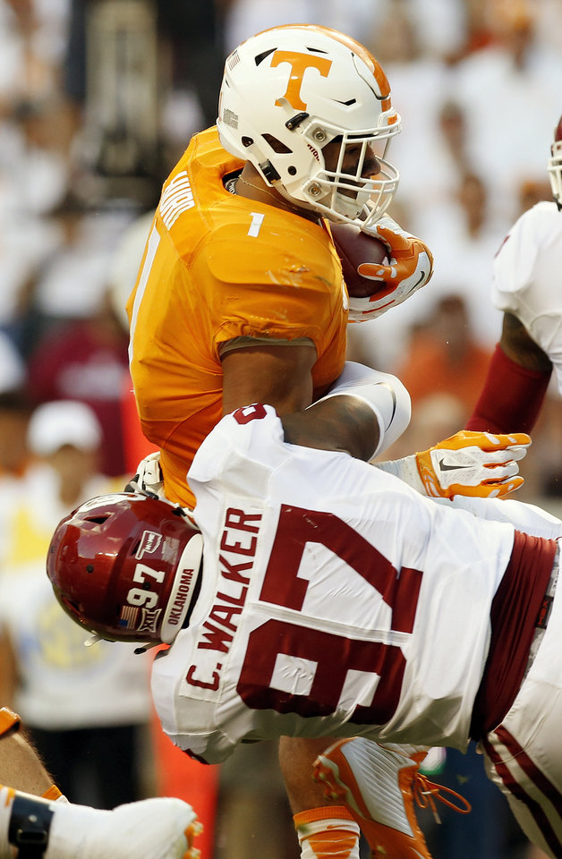 Photo - Oklahoma's Charles Walker (97) stops Tennessee's Jalen Hurd (1) on a carry during the college football game between the Oklahoma Sooners (OU) and the Tennessee Volunteers at Neyland Stadium in Knoxville, Tennessee, Saturday, Sept. 12, 2015. Photo by Nate Billings, The Oklahoman