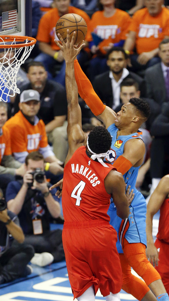 Photo - Oklahoma City's Russell Westbrook (0) takes the ball to the hoop as Portland's Maurice Harkless (4) defends in the first quarter during Game 3 in the first round of the NBA playoffs between the Portland Trail Blazers and the Oklahoma City Thunder at Chesapeake Energy Arena in Oklahoma City, Friday, April 19, 2019. Photo by Nate Billings, The Oklahoman