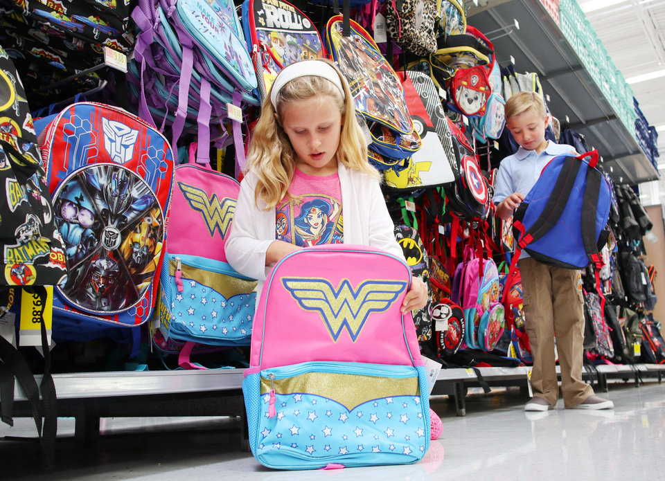 Photo - Ella Kate Starke, 8, and Connor Shellem, 10, check out super hero backpacks at Belle Isle Walmart, Tuesday July 25, 2017. Photo by Doug Hoke, The Oklahoman