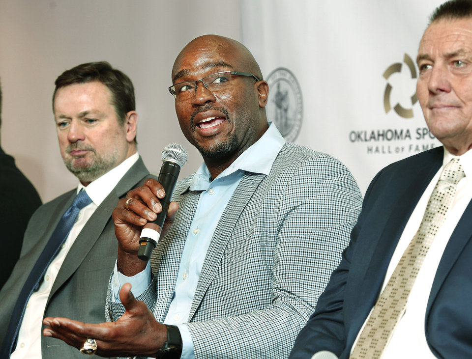 Photo - The Oklahoma Sports Hall of Fame Induction Class of 2019 was introduced Tuesday, Feb. 19, 2019, at the organization's leadership luncheon at the Jeaneen and Bob Naifeh Family & Bud Wilkinson Event Center.  From left are Bob Stoops, Will Shields and Mike Moore . Also present, but not pictured, are Patty Gasso, Kendall Cross and Mickey Tettleton. Inductee Lou Henson was unable to be present at the luncheon. Photo by Jim Beckel, The Oklahoman.