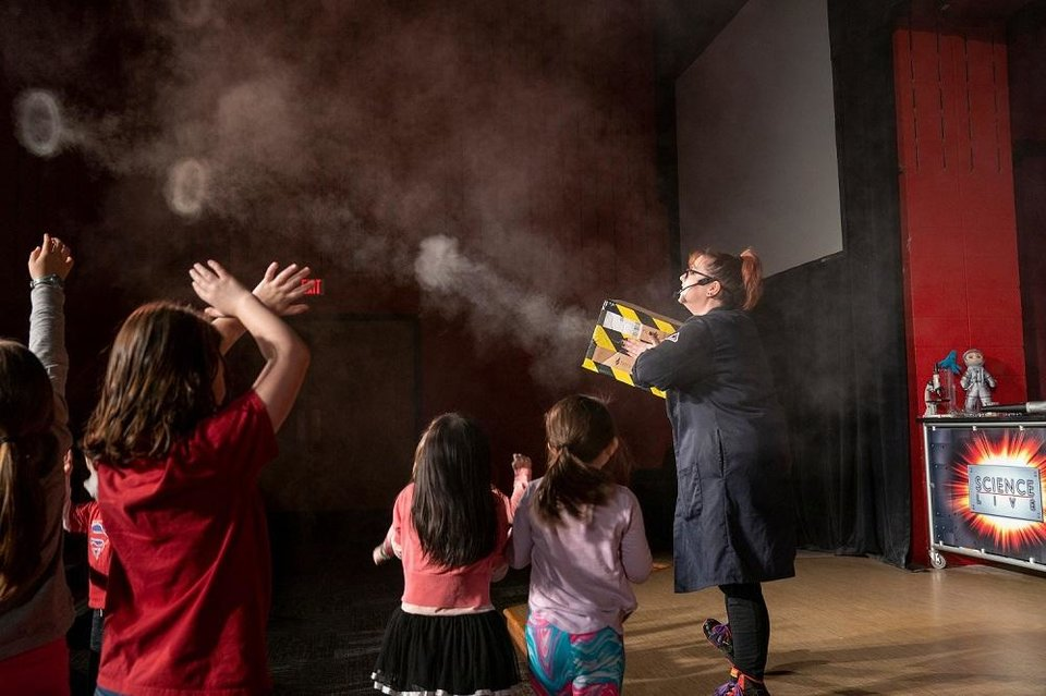 Photo - Lauren Martin performs a Science Live! show at Science Museum Oklahoma. While the museum is temporarily closed during the coronavirus pandemic, staffers are bringing science experiments, story times and more to social media to engage with the publc. [Nick Oxford photo]