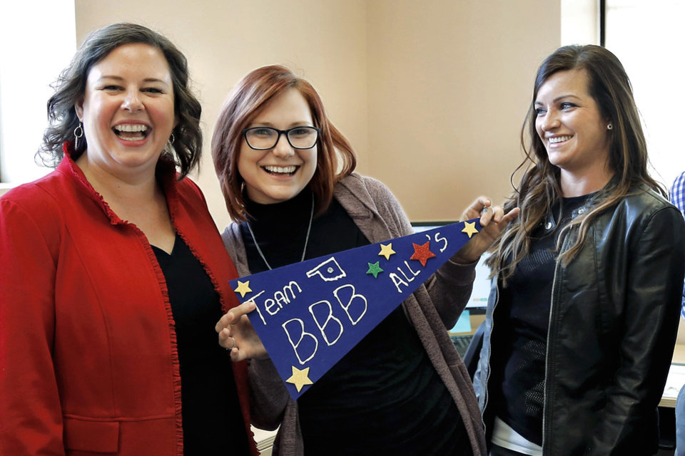 Photo -  Better Business Bureau of Central Oklahoma Inc. President and CEO Kitt Letcher, left, with ReMerge program graduate and BBB employee Jessica Rider, center, and Brandi Davis, right, who faced years behind bars after she was arrested for allegedly shoplifting and possessing a syringe. An opioid addict, Davis has been in the ReMerge program for nearly a year, and is now working at the BBB. [Photo by Jim Beckel, The Oklahoman]
