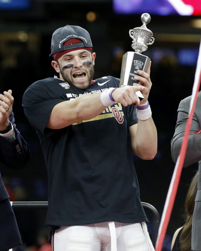Photo - Oklahoma's Baker Mayfield (6) celebrates with the Most Oustdanding Player trophy after the Allstate Sugar Bowl between the University of Oklahoma Sooners (OU) and the Auburn University Tigers at the Mercedes-Benz Superdome in New Orleans, Tuesday, Jan. 3, 2017.  Photo by Bryan Terry, The Oklahoman