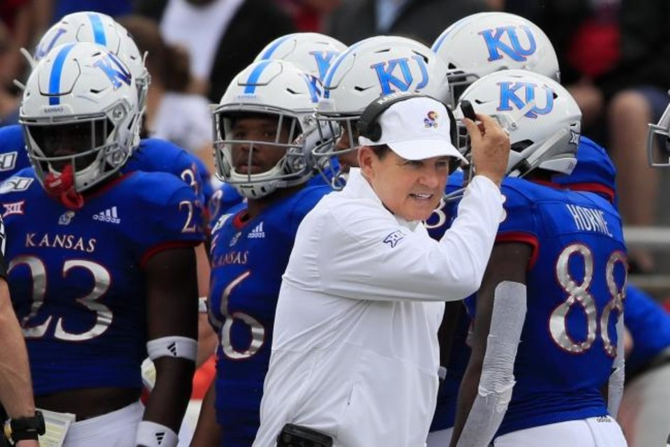 Photo -  Kansas coach Les Miles works the sidelines during the Jayhawks' game against West Virginia. AP Photo/Orlin Wagner]
