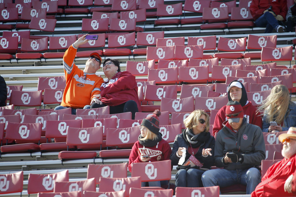 Photo - Fans take a photo before the start of a Bedlam college football game between the University of Oklahoma Sooners (OU) and the Oklahoma State University Cowboys (OSU) at Gaylord Family-Oklahoma Memorial Stadium in Norman, Okla., Nov. 10, 2018.  Photo by Bryan Terry, The Oklahoman