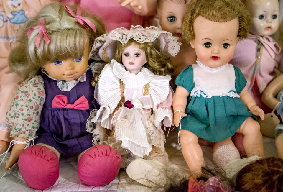 Photo -  A trio of dolls is shown among Imogene McDowell's collection of more than 500 dolls. [Photo by Chris Landsberger, The Oklahoman]