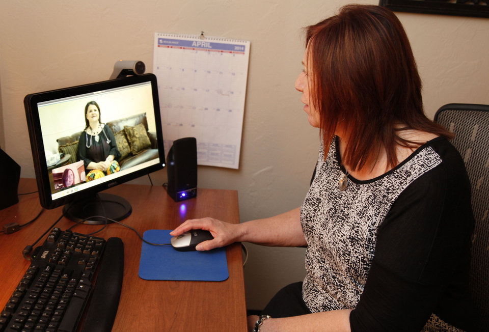 Photo - File: Behavioral Health Therapist Desma McKinney speaks to a client by video in Ft. Cobb, Oklahoma from her office in Oklahoma City. [The Oklahoman archives]