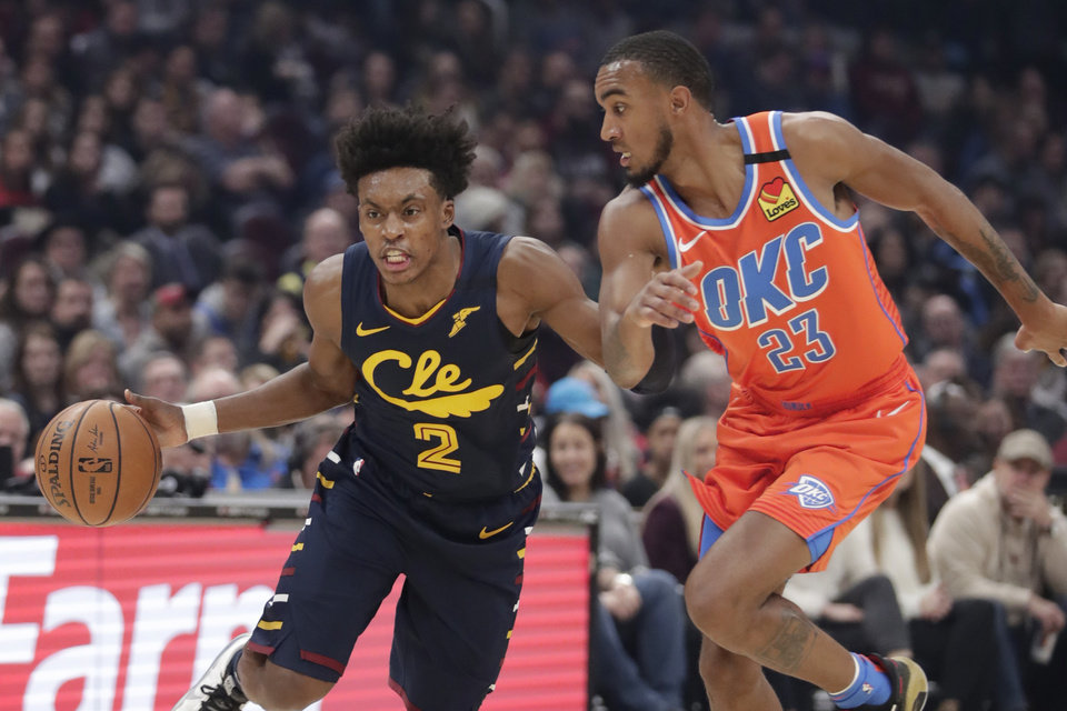 Photo - Cleveland Cavaliers' Collin Sexton (2) drives past Oklahoma City Thunder's Terrance Ferguson (23) in the first half of an NBA basketball game, Saturday, Jan. 4, 2020, in Cleveland. [AP Photo/Tony Dejak]