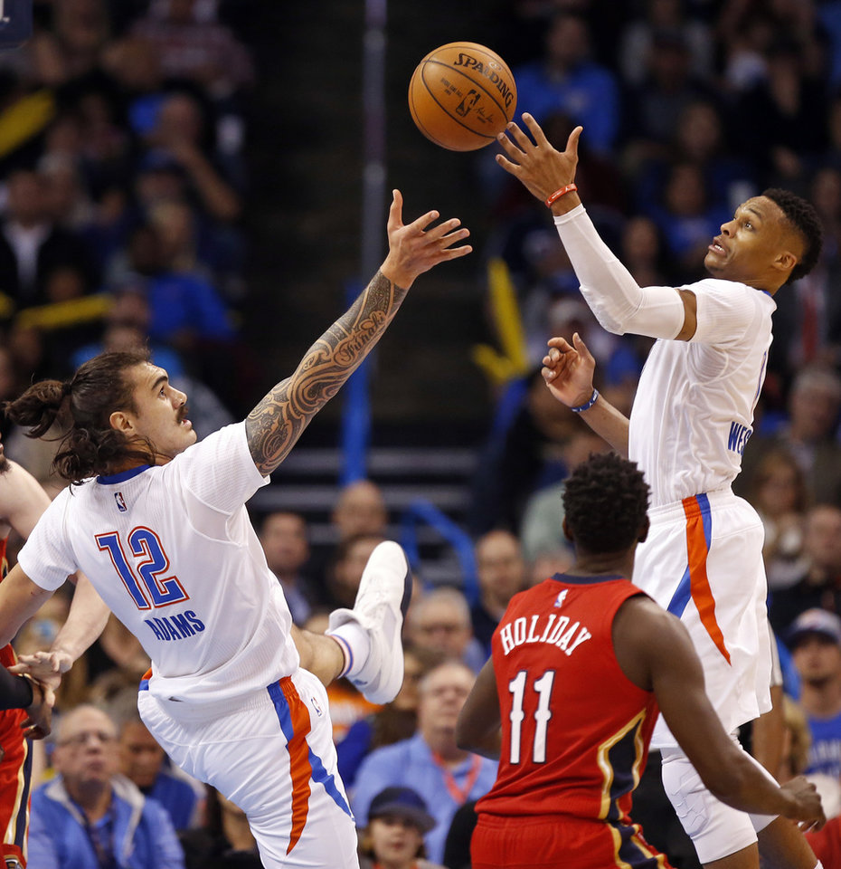 Photo - Oklahoma City's Russell Westbrook (0) and Steven Adams (12) chase a rebound near New Orleans' Jrue Holiday (11) during an NBA basketball game between the New Orleans Pelicans and the Oklahoma City Thunder at Chesapeake Energy Arena in Oklahoma City, Thursday, Feb. 11, 2016. Oklahoma City won 121-95. Photo by Nate Billings, The Oklahoman