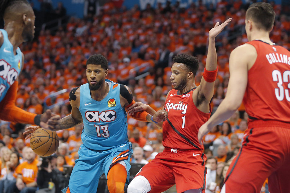 Photo - Oklahoma City's Paul George (13) tries to get past Portland's Evan Turner (1) during Game 3 in the first round of the NBA playoffs between the Portland Trail Blazers and the Oklahoma City Thunder at Chesapeake Energy Arena in Oklahoma City, Friday, April 19, 2019. Photo by Bryan Terry, The Oklahoman