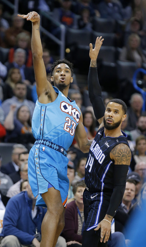 Photo - Oklahoma City's Terrance Ferguson (23) reacts next to Orlando's D.J. Augustin (14) after shooting a basket during the NBA game between the Oklahoma City Thunder and the Orlando Magic at the Chesapeake Energy Arena  Tuesday, Feb. 5, 2019. Photo by Sarah Phipps, The Oklahoman