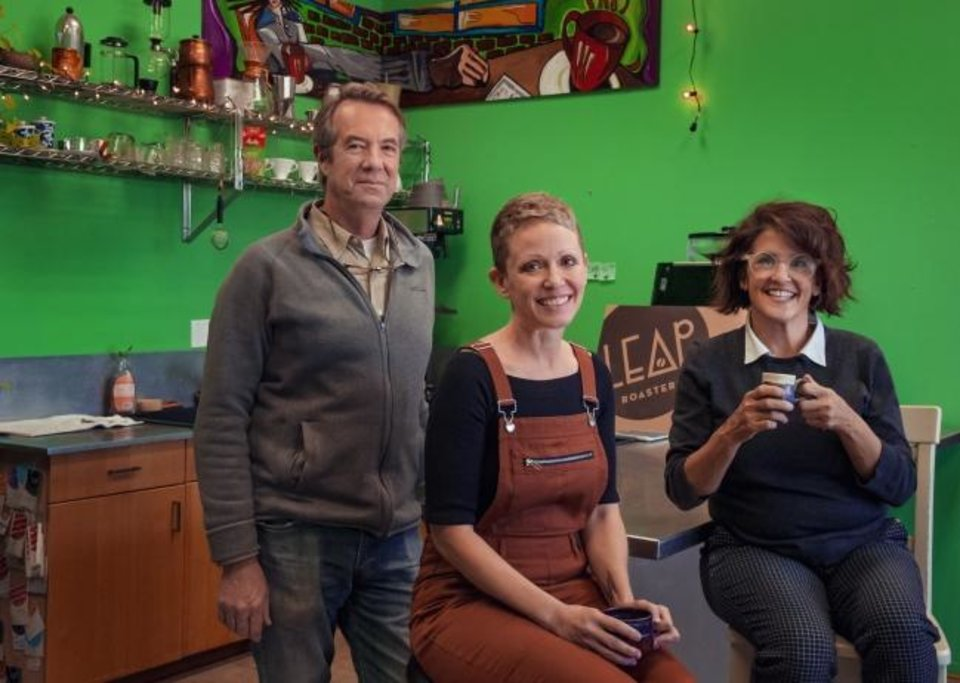 Photo -  Eric Starkey, Angie LaPaglia and Kari Hirst Starkey, from left, pose for a photo at LEAP Coffee Roasters on Monday, Jan. 27, 2020, in Oklahoma City, Okla.   [Chris Landsberger/The Oklahoman]