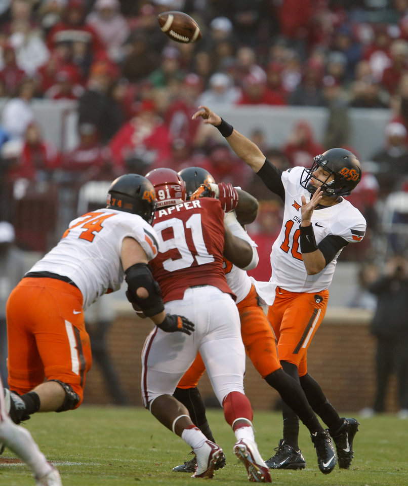 Photo - Oklahoma State's Mason Rudolph (10) throws a pass during a Bedlam college football game between the University of Oklahoma Sooners (OU) and the Oklahoma State Cowboys (OSU) at Gaylord Family-Oklahoma Memorial Stadium in Norman, Okla., Saturday, Dec. 6, 2014. Photo by Bryan Terry, The Oklahoman
