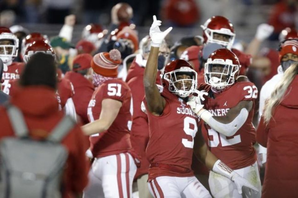 Photo -  Oklahoma's D.J. Graham (9) celebrates beside Delarrin Turner-Yell (32) after Graham intercepted a pass during college football game between the University of Oklahoma Sooners (OU) and the Baylor Bears at Gaylord Family-Oklahoma Memorial Stadium in Norman, Okla., Saturday, Dec. 5, 2020. [Bryan Terry/The Oklahoman]