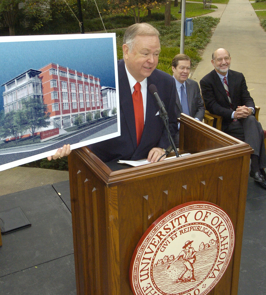 Photo - Norman, OK 11/8/04  University of Oklahoma President David Boren shows an artist's rendering of the newly proposed addition to the School of Engineering made possible by a 10 million dollar grant from Devon Energy. Behind is Devon Energy CEO Larry Nichols and OU Engineering Dean Skip Porter. Staff photo by Paul Hellstern.