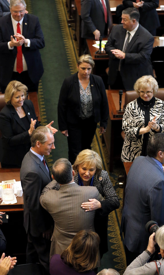Photo - Gov. Mary Fallin greets legislators as she makes her way to the start of the Oklahoma Legislature's 2016 State-of-the-State Address by Gov. Mary Fallin in the chamber of the House of Representatives at the Oklahoma state capitol on Monday, Feb. 1, 2016, in Oklahoma City, Okla. Photo by Chris Landsberger, The Oklahoman