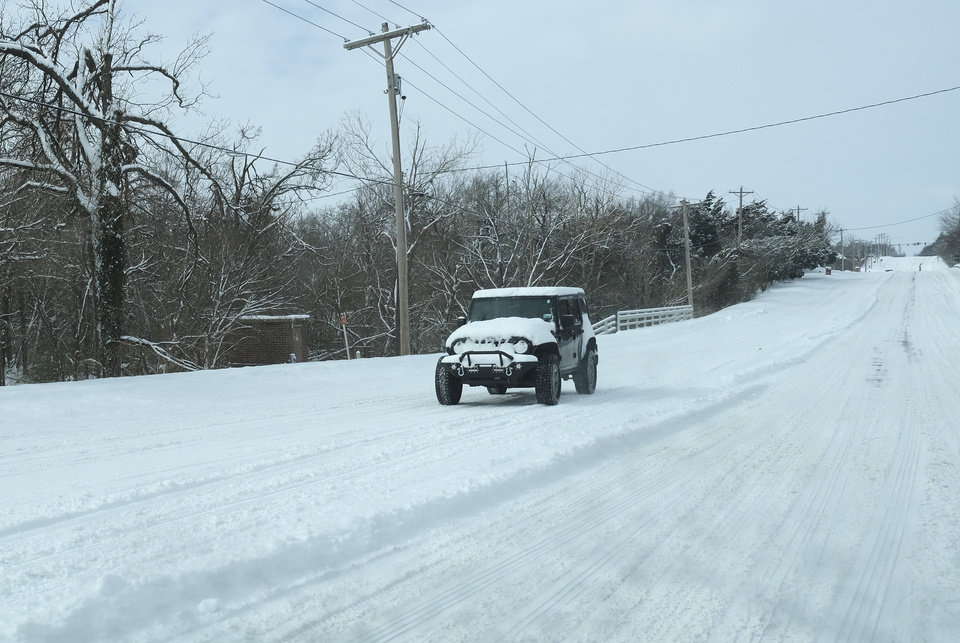 Photo - A Jeep makes its way east on 33rd St near Coltrane in Edmond Wednesday, February 17, 2021. [Doug Hoke/The Oklahoman]