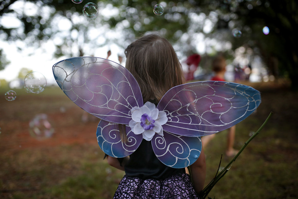 Photo -  A child chases bubbles dressed as a fairy at last year's Fairy Ball at First Christian Church in Oklahoma City. The ball is sponsored by Paseo Arts Association, Theatre Upon a StarDanceSwan and the Oklahoma Arts Council. [Photo by Sarah Phipps, The Oklahoman Archives]
