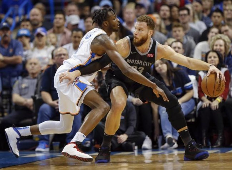 Photo -  Detroit's Blake Griffin, a former OU standout, tries to get past Oklahoma City's Jerami Grant during Friday night's game at Chesapeake Energy Arena. Griffin scored a game-high 45 points. [Nate Billings/The Oklahoman]