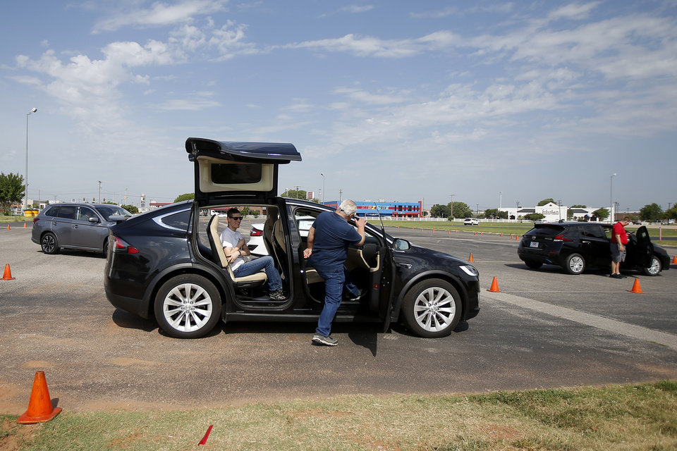 Photo -  An item of interest at OG&E's Electric Vehicle Ride and Drive event was this Tesla Model X.
