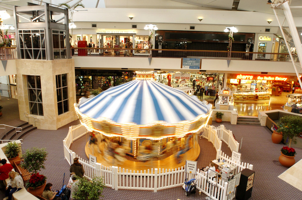 Photo -  The carousel originally added to Crossroads Mall in 2003, as shown in this archive photo, will soon be relocated to the Myriad Botanical Gardens. [THE OKLAHOMAN ARCHIVES]