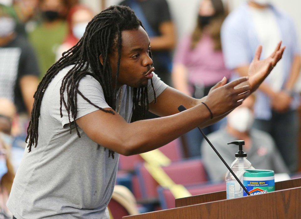 Photo - T.J. Thompson, a Black Lives Matter protesters, who want to defund the police, spoke to the Norman City Council, Tuesday, June 9, 2020. [Doug Hoke/The Oklahoman]