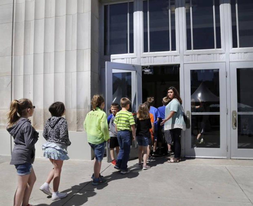 Photo - Students enter the Civic Center to watch an Oklahoma City Ballet ArtsReach performance of