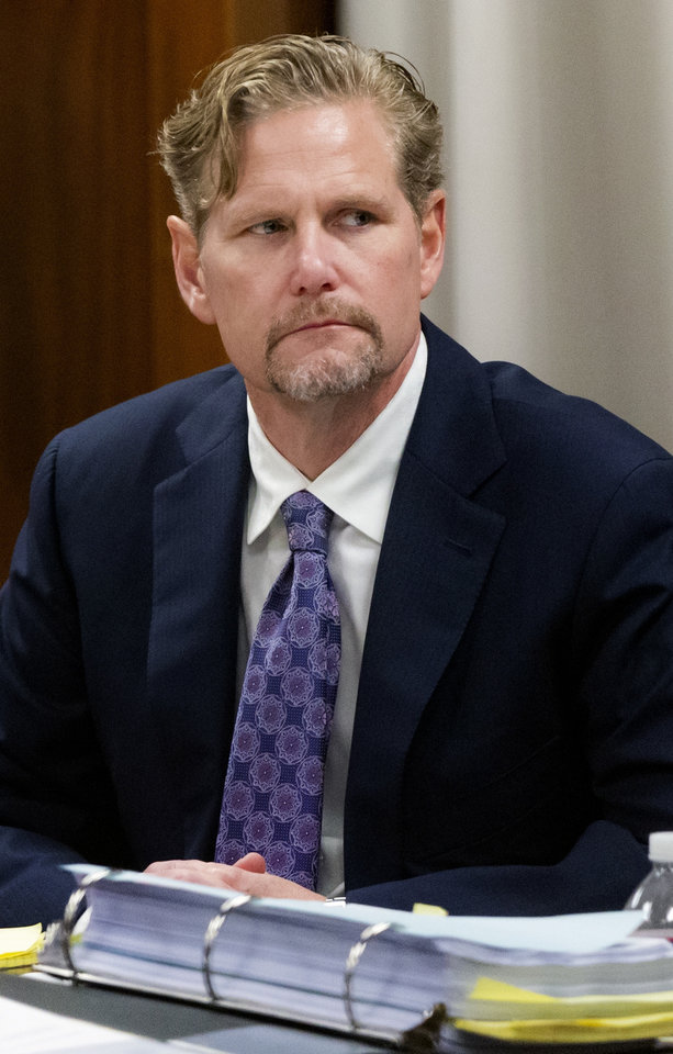 Photo -  Edmond cardiologist Dr. Bryan Frank Perry sits in the courtroom during jury selection at the Oklahoma County courthouse on Monday. Perry is an accused of striking and killing a motorcyclist with his car, then leaving the scene. [Chris Landsberger/The Oklahoman]