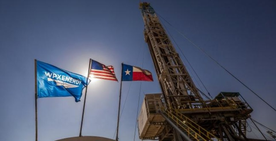 Photo -  A rig drills a Permian Basin location for WPX Energy in 2017. WPX's $2.5 billion buy of private Felix Energy II was among the biggest acquisitions in 2019.