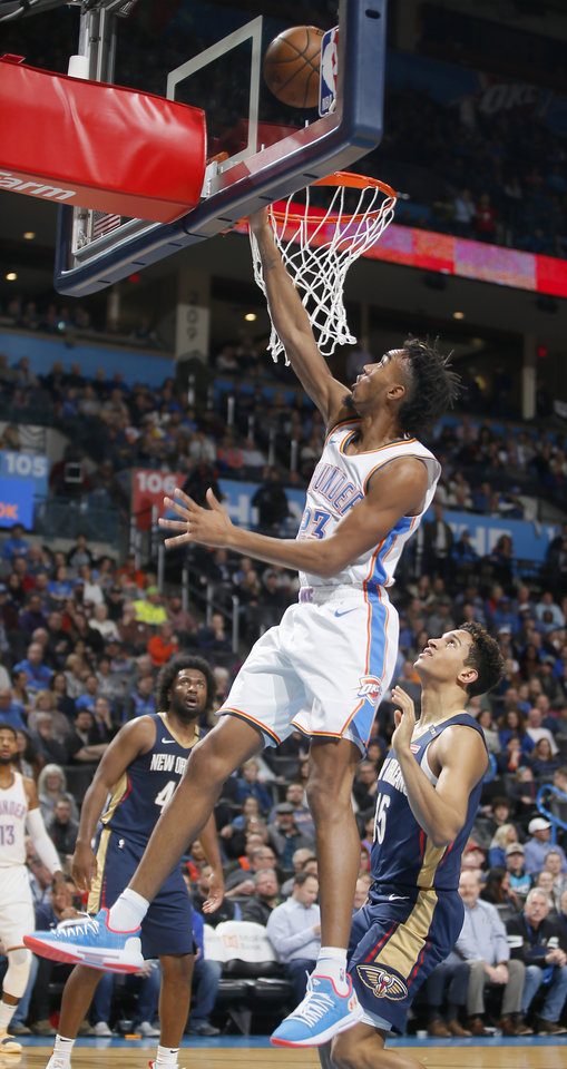 Photo - Oklahoma City's Terrance Ferguson (23) goes to the basket past New Orleans' Frank Jackson (15) during an NBA basketball game between the Oklahoma City Thunder and the New Orleans Pelicans at Chesapeake Energy Arena in Oklahoma City, Thursday, Jan. 24, 2019. Photo by Bryan Terry, The Oklahoman