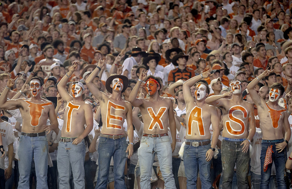 Photo - Texas fans celebrate a touchdown against Oklahoma State during an NCAA college football game Saturday, Sept. 21, 2019, in Austin, Texas. (Nick Wagner/Austin American-Statesman via AP)