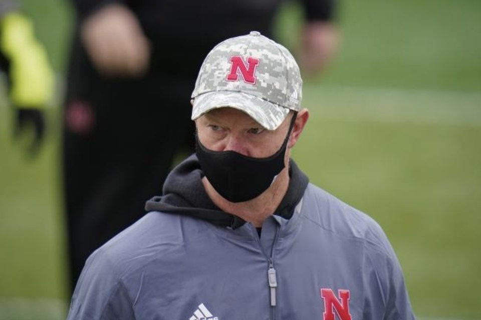 Photo -  Nebraska coach Scott Frost walks off the field following a 41-23 loss Saturday against Illinois. [AP Photo/Nati Harnik]