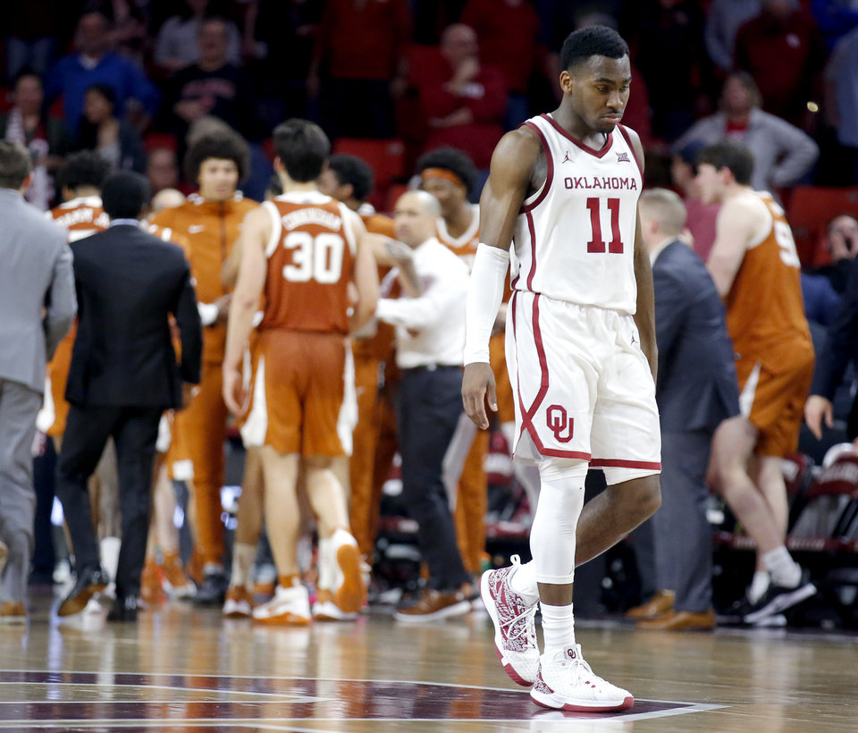 Photo - Oklahoma's De'Vion Harmon (11) walks off the court after for a time out after Texas made a go-ahead 3-point basket during the men's basketball game between Oklahoma and Texas at Lloyd Noble Center in Norman, Okla., Tuesday, March 3, 2020. OU lost 52-51. [Sarah Phipps/The Oklahoman]