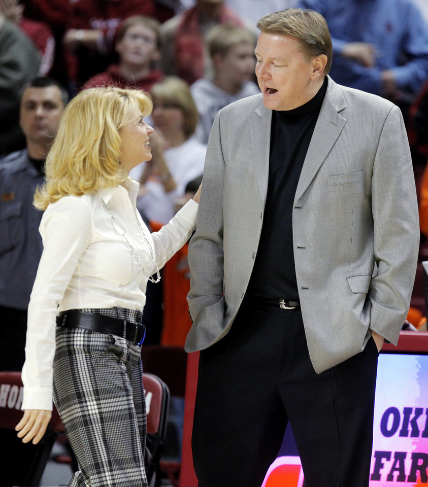 Photo - OU head coach Sherri Coale and OSU head coach Kurt Budke talk before the Bedlam women's college basketball game between Oklahoma State University and University of Oklahoma at the Lloyd Noble Center in Norman, Okla., Saturday, February 28, 2009. BY NATE BILLINGS, THE OKLAHOMAN