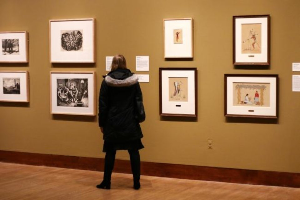 Photo -  A visitor looks at artworks in October in the Oklahoma City Museum of Art exhibit