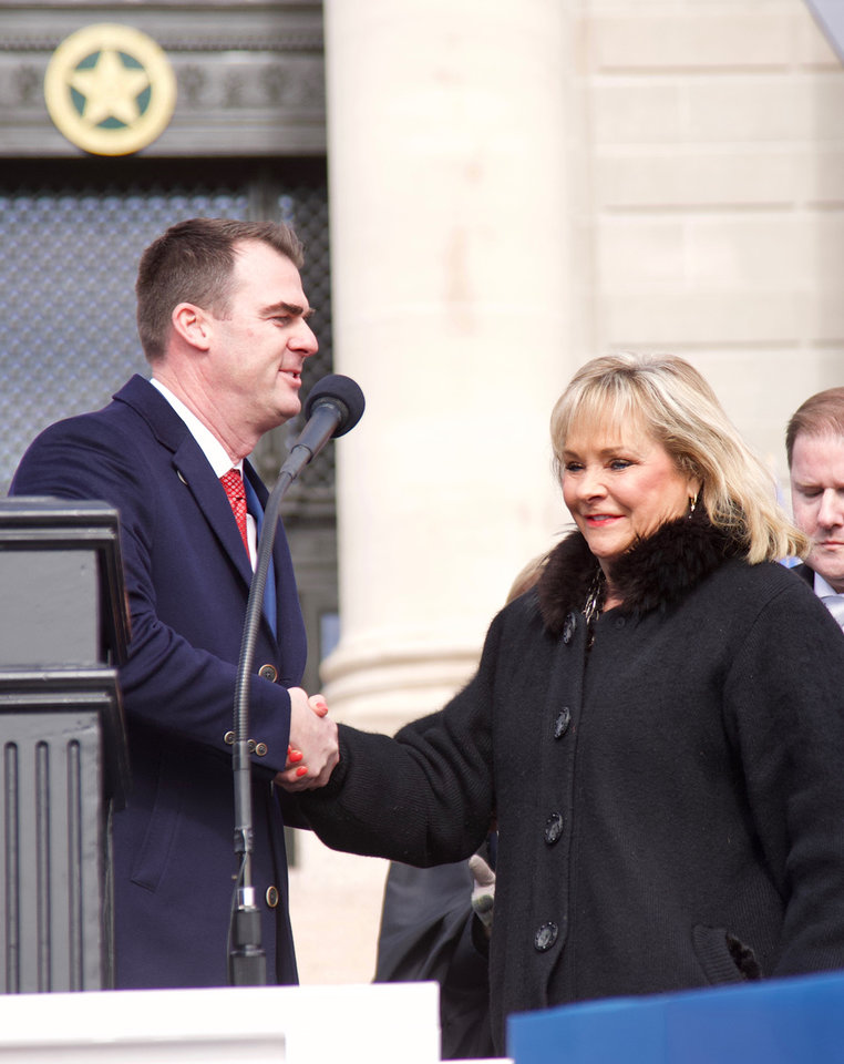 Photo - Gov. Kevin Stitt shakes hands with former Gov. Mary Fallin during the inauguration ceremony of new Oklahoma Gov. Kevin Stitt at the Oklahoma State Capitol in Oklahoma City, Okla. on Monday, Jan. 14, 2019. Photo by Chris Landsberger, The Oklahoma
