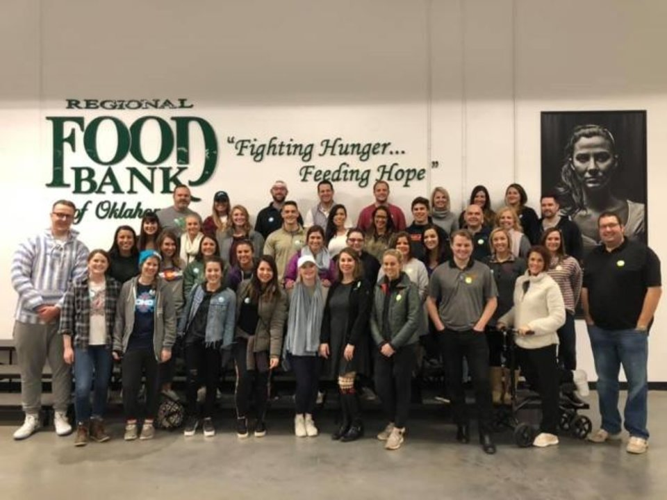 Photo -  Employees at Addison Group's Oklahoma City office volunteer at the Regional Food Bank of Oklahoma.