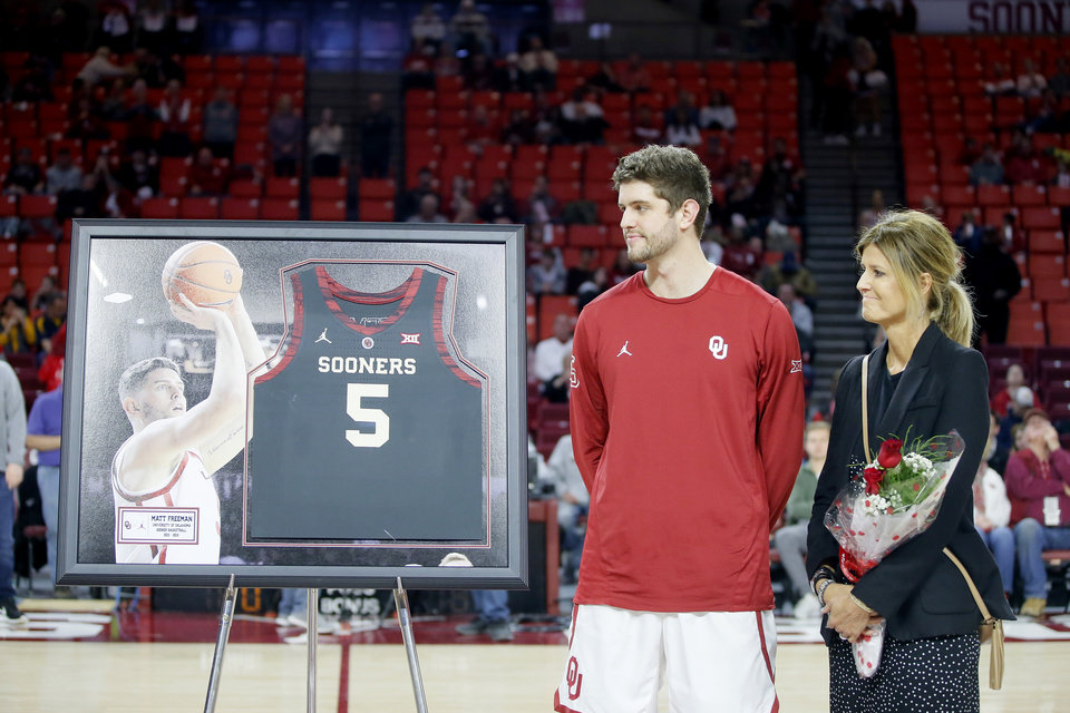 Photo - Oklahoma's Matt Freeman is honored during senior day before an NCAA college basketball game between the University of Oklahoma (OU) and West Virginia at Lloyd Noble Arena in Norman, Okla.,  Saturday, March 2, 2019. Oklahoma won 92-80. Photo by Bryan Terry, The Oklahoman