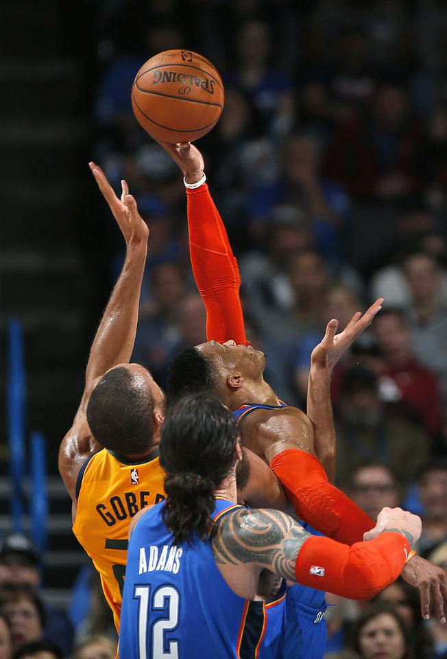 Photo - Oklahoma City's Russell Westbrook (0) defends against Utah's Rudy Gobert (27) during the NBA game between the Oklahoma City Thunder and the Utah Jazz at the Chesapeake Energy Arena, Friday, Feb. 22, 2019. Photo by Sarah Phipps, The Oklahoman