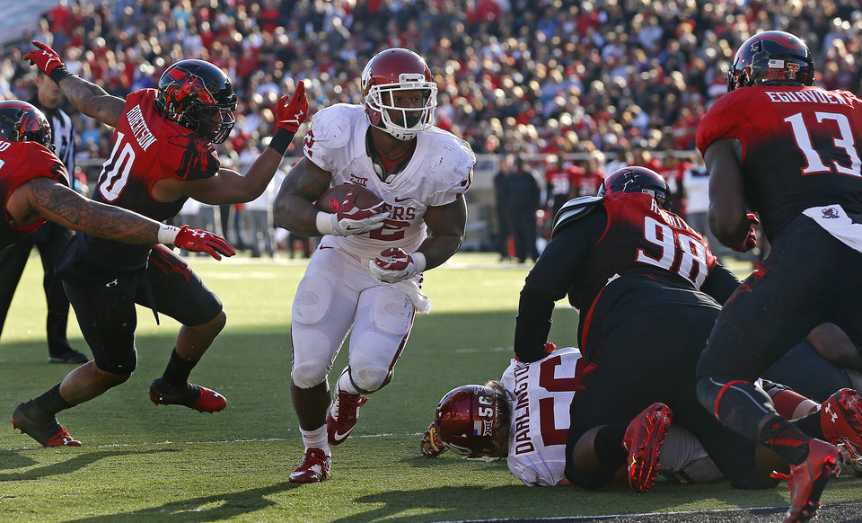 Photo - Oklahoma's Samaje Perine (32) runs for a touchdown during a college football game between the University of Oklahoma Sooners (OU) and the Texas Tech Red Raiders at Jones AT&T Stadium in Lubbock, Texas, Saturday, November 15, 2014.  Photo by Bryan Terry, The Oklahoman