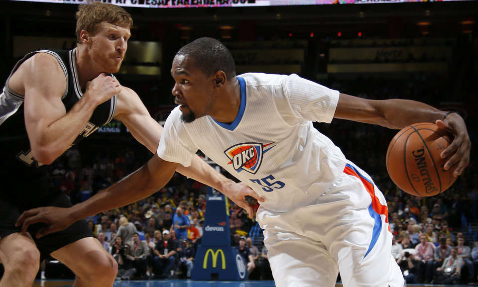 Photo - Oklahoma City's Kevin Durant (35) goes past San Antonio's Matt Bonner (15) during an NBA basketball game between the Oklahoma City Thunder and the San Antonio Spurs at Chesapeake Energy Arena in Oklahoma City, Saturday, March 26, 2016. Oklahoma City won 11-92. Photo by Bryan Terry, The Oklahoman