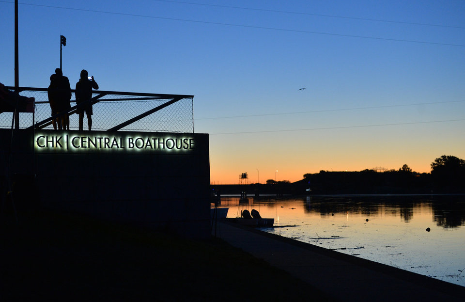 Photo -  Rowing participants take photos of the sunrise before the OCU Head of the Oklahoma Regatta on Sunday during the 2017 Oklahoma Regatta Festival. [PHOTO BY JACKIE DOBSON, FOR THE OKLAHOMAN]
