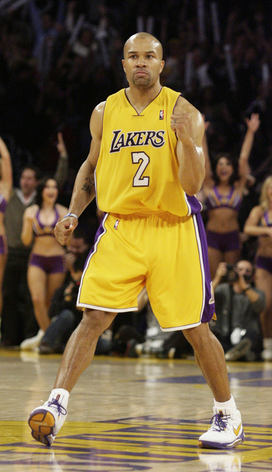 Photo - L.A. LAKERS: Los Angeles Lakers' Derek Fisher pumps his fist after making a 3-point shot to tie the game against New Orleans in the final seconds of the fourth quarter of an NBA basketball game in Los Angeles on Friday, Feb. 20, 2009. The Lakers won in overtime 115-111. (AP Photo/Francis Specker)