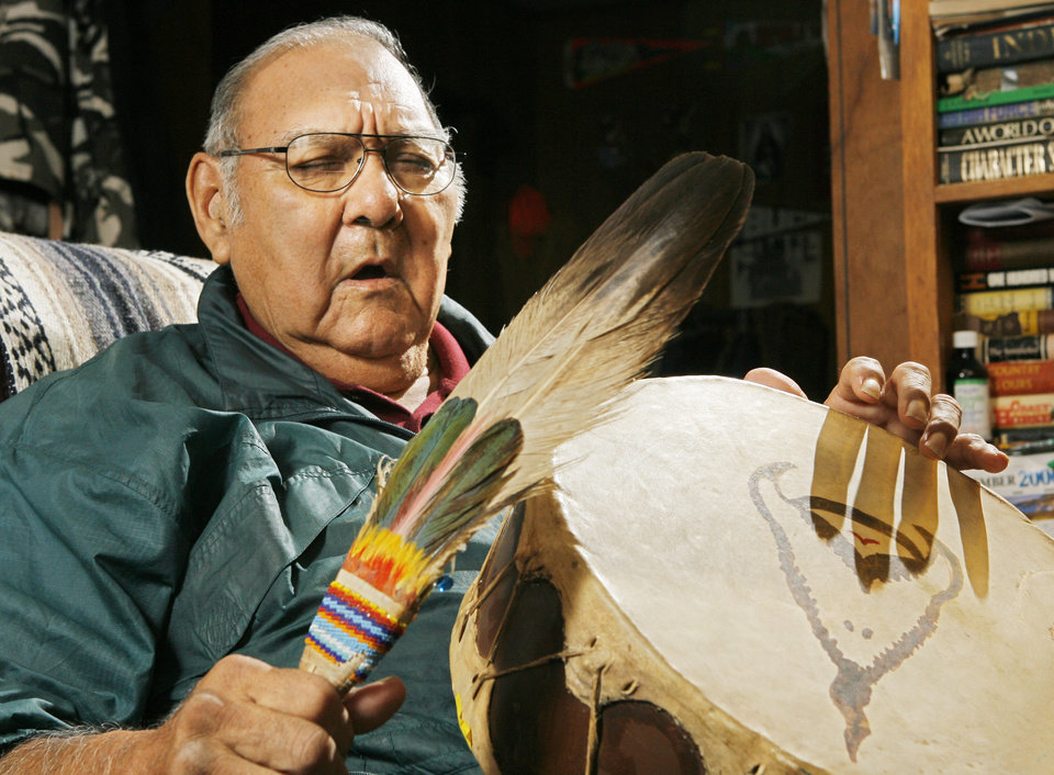 Photo - Kiowa elder Evans Ray Satepauhoodle sings a family song in his home in Hominy, Tuesday, December 5, 2006.   Satepauhoodle  is working with Rogers State University music professor Hugh Foley to record Kiowa songs. BY DAVID MCDANIEL, THE OKLAHOMAN. ORG XMIT: KOD