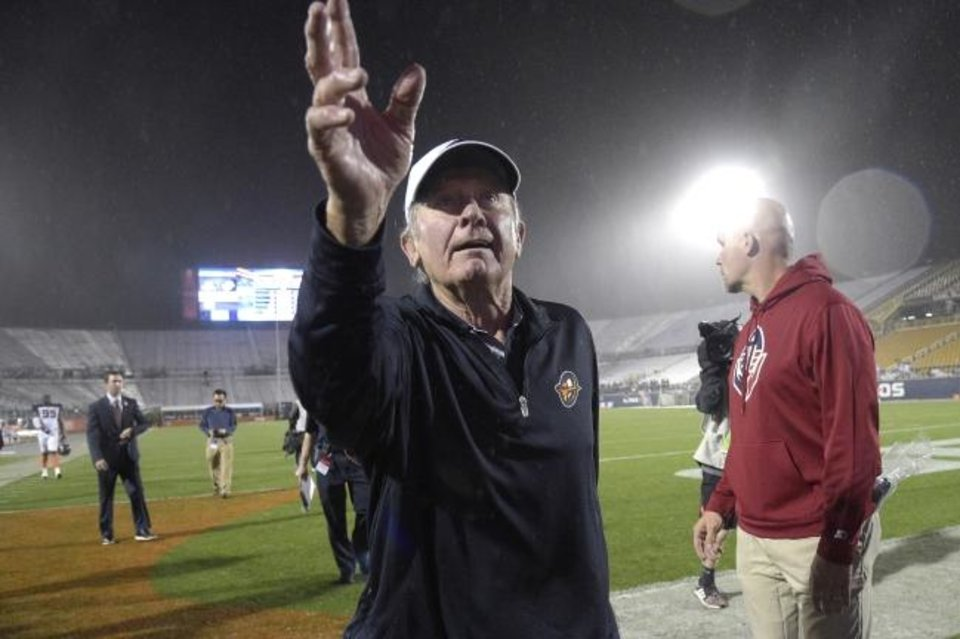Photo -  Orlando Apollos coach Steve Spurrier acknowledges fans in the stands after the team's Alliance of American Football game against the Atlanta Legends on Feb. 9. [AP Photo/Phelan M. Ebenhack]